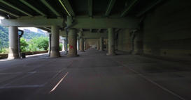 Perspective of Driving Under City Through Cement Structure Footage