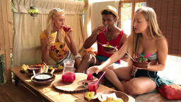 Group of young friends enjoying meal on tree house Footage