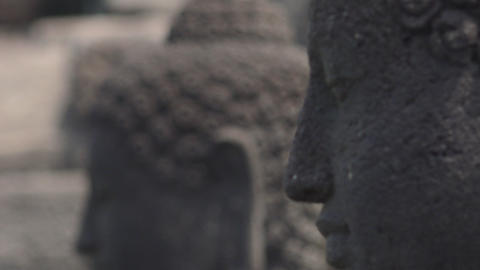 Close up follow focus video of Buddha statues in Borobudur Temple. Indonesia Footage