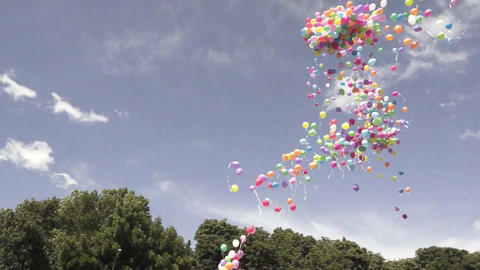 Large group of colorful balloons released into the sky during celebration Footage