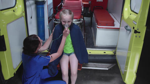 Girl sit an ambulance car with oxygen mask Live Action