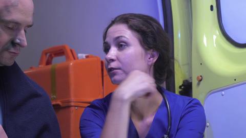 Nurse in uniform talk to sick man, calm him down Footage