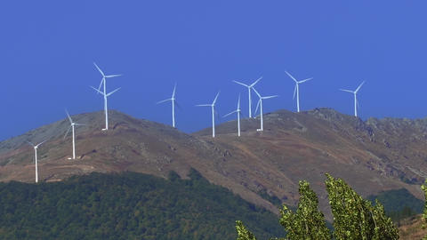 Renewable energy wind turbines arrays on vertical axis at a mountain rotating Live Action