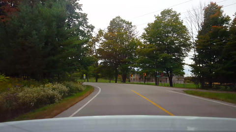 Rear View From Back of Car Driving Rural Countryside Road Under Overcast Day. Car Point of View POV Footage
