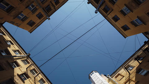 Sky and buildings with a web of wires Live Action