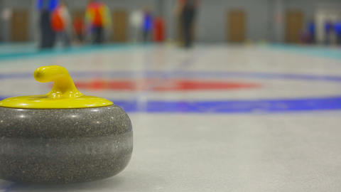 The player rolls a curling stone Footage