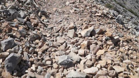 Walking on a rocky path Footage