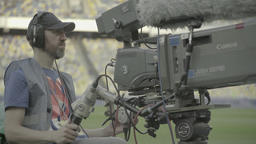 Broadcast on the stadium during sporting events. Cameraman with a camera Footage