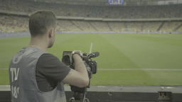 The cameraman shoots the news on the stadium Footage