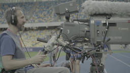 Cameraman with a big professional camera in the broadcast of the match at the st Footage
