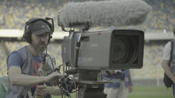 Cameraman with a big professional camera in the stadium during TV broadcast Footage