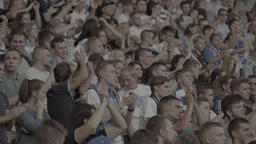 A crowd of fans at the stadium clap Footage