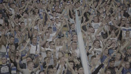 The crowd of football fans at the stadium clap their hands during a match Footage