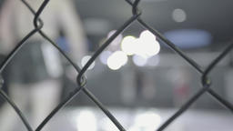 MMA. Silhouettes MMA fighters during combat in the cage Footage