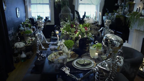 Skeletons gathered around the table celebrate Halloween Footage