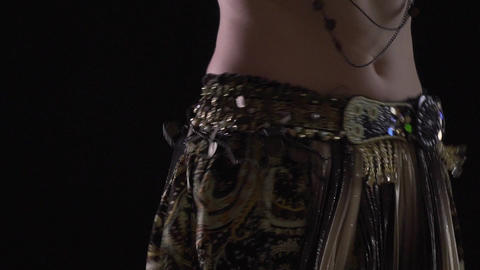 Slim woman in eastern dress is dancing the belly dance, close up Live Action