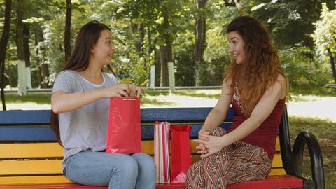 Young attractive girl receiving a gift from her friend Footage