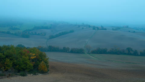 Dense Morning Fog in the Hills of Tuscany. Time Lapse 4K Footage