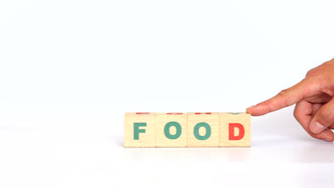 Food word built with wooden cubes Footage