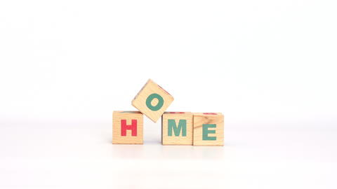 Cubes with letters gathered into home word Footage