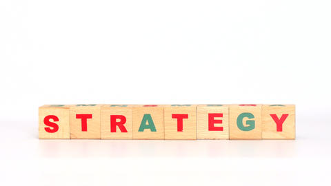 Strategy word comes out of letters on game cubes Footage