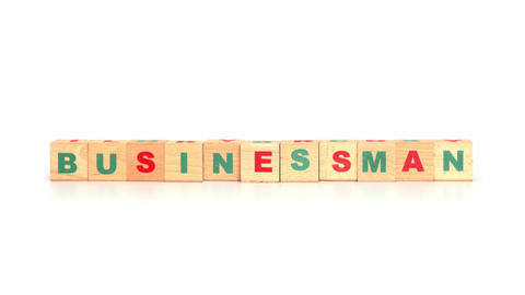 Businessman word made from wooden cubes Footage