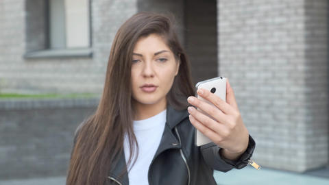 Frustrated woman shows on the broken screen was set up smartphone Live Action