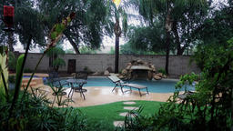 Establishing Shot of Residential Arizona Backyard Pool in a Monsoon Footage