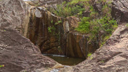Small Streams Fall into Round Hole Pool from Rock Tops Footage