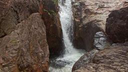Foamy Cascade Waterfall to Deep Pool among Rocks Footage