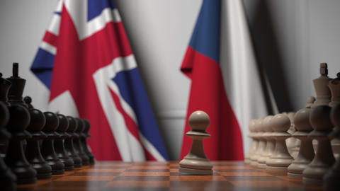 Flags of Great Britain and the Czech Republic behind pawns on the chessboard Live Action