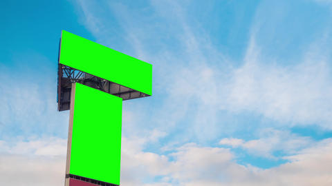 Timelapse - two blank green billboards and moving white clouds against blue sky Footage