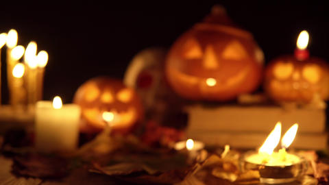 Two Halloween pumpkins and a skull gradually appear in camera panning to focus Live Action