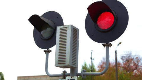 A rail road signal with one red light on white. Railway Traffic Signal Red Stop Live Action