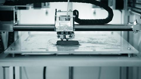 3D printer working. Fused deposition modeling Live Action