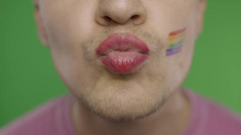 Bearded man with painted lips kiss on the camera. LGBT community. Transsexual Footage