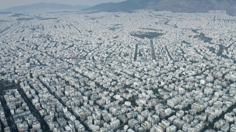 High altitude aerial view of the cityscape Athens in the evening, Greece Footage