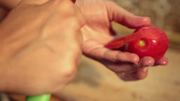 Close up woman hands peeling tomato Live Action
