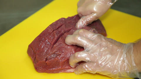 Cook Cuts a piece of Meat Footage
