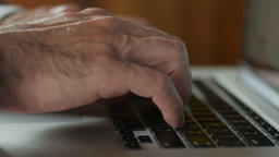 Dolly close up of man typing on laptop computer keyboard Footage