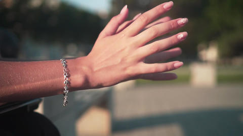 Closeup of a girl's hand with a beautiful manicure, on her hand is a jewelry Live Action