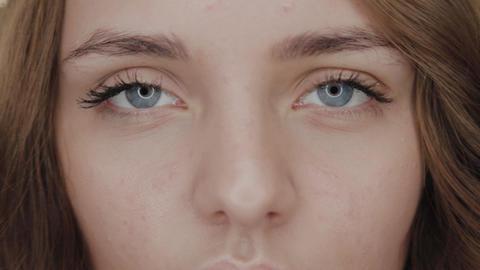 Beautiful girl in a beauty salon near the backlit mirror. Woman portrait Footage