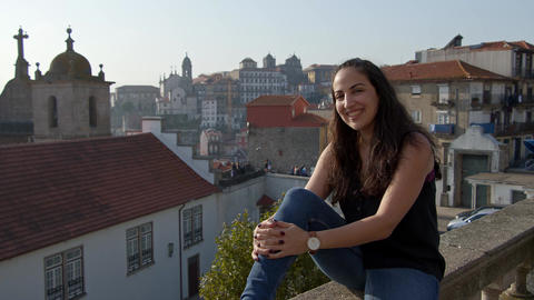 Young an happy woman in the historic district of Porto Footage