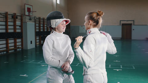 Two young women fencers in white protective suits... Stock Video Footage