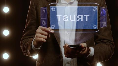 Businessman shows hologram Trust Live Action