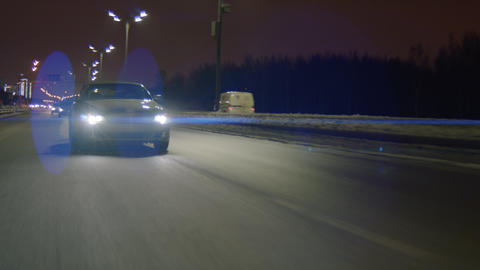 speed car drives along highway at cold dark winter night Live Action