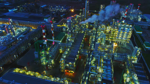 illuminated gas and oil refinery complex at night aerial Footage