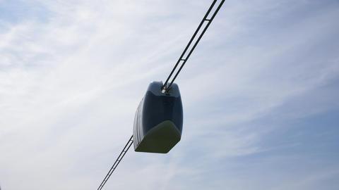 unibus drives along string railway against blue sky Footage