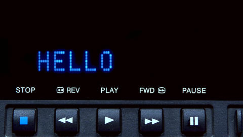 "Disc player with screen. The word ""hello"" is written on the screen Live Action"