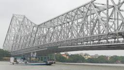 Boat passing under Howrah bridge,Kolkata,India Footage
